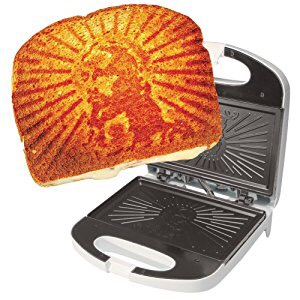 A phot of Jesus on a grilled cheese sandwich from a grill press