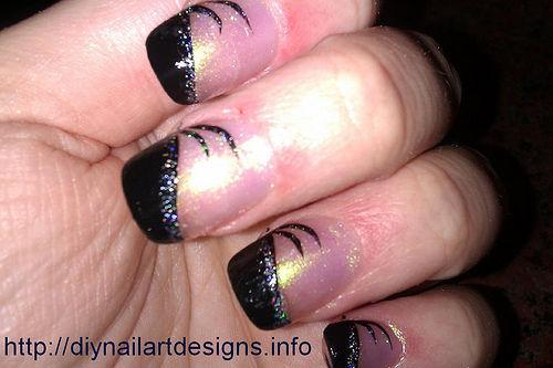 Faddish Nail Design With Black Hearts And Tips