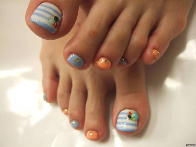 Blue And Pink Toe Nails With White Flowers Design Idea