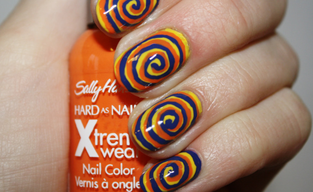Yellow Purple And Orange Color Spiral Nail Art