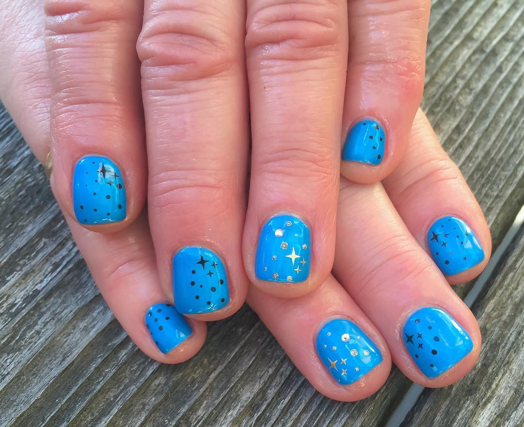Blue Acrylic Short Nails With Black And Gold Stars Design Idea