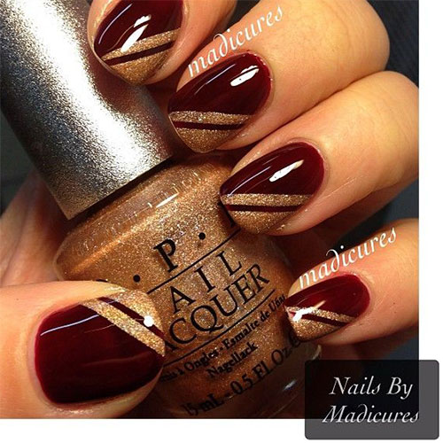 Dark Glossy Red Nails With Gold Stripes Design Nail Art