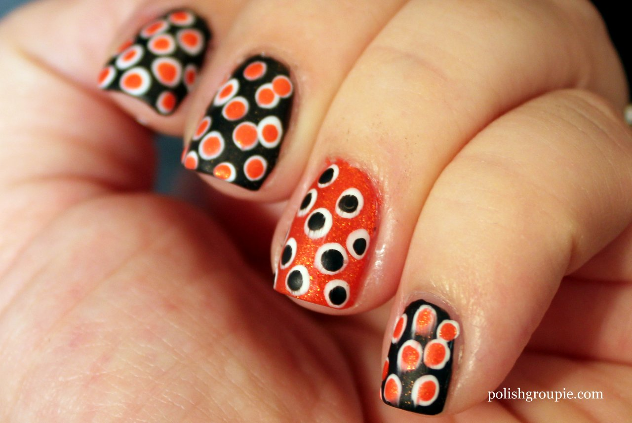 Orange And Black Polka Dots Nail Art