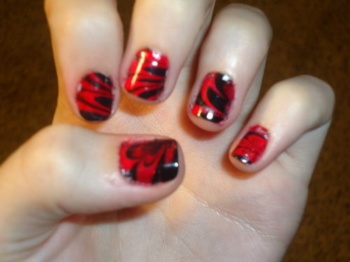 Red And Black Water Marble Nail Art Design Idea