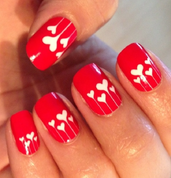 Red Nails With White Hearts Nail Art Design