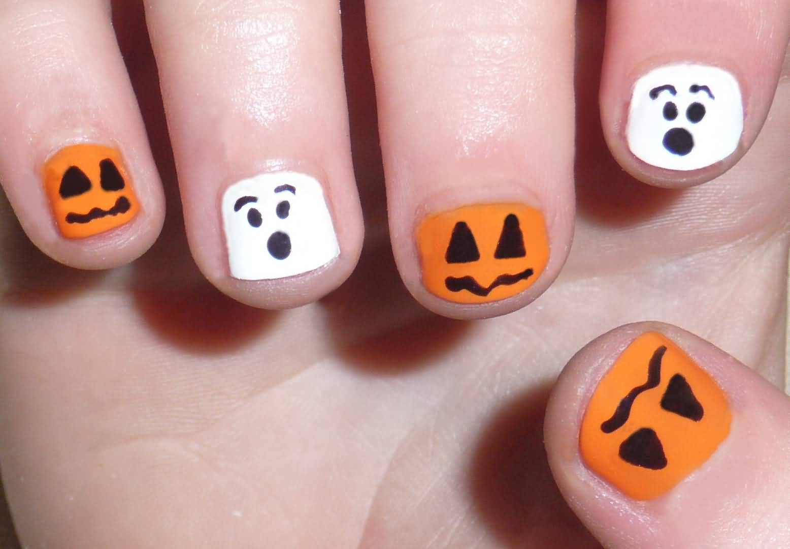 White And Orange Matte Scary Faces Nail Art