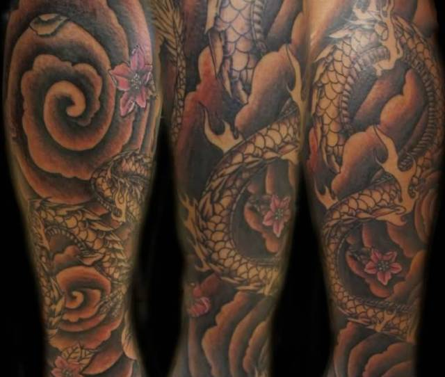 Amazing Black Ink Dragon Tattoo Design For Leg By Lavonne