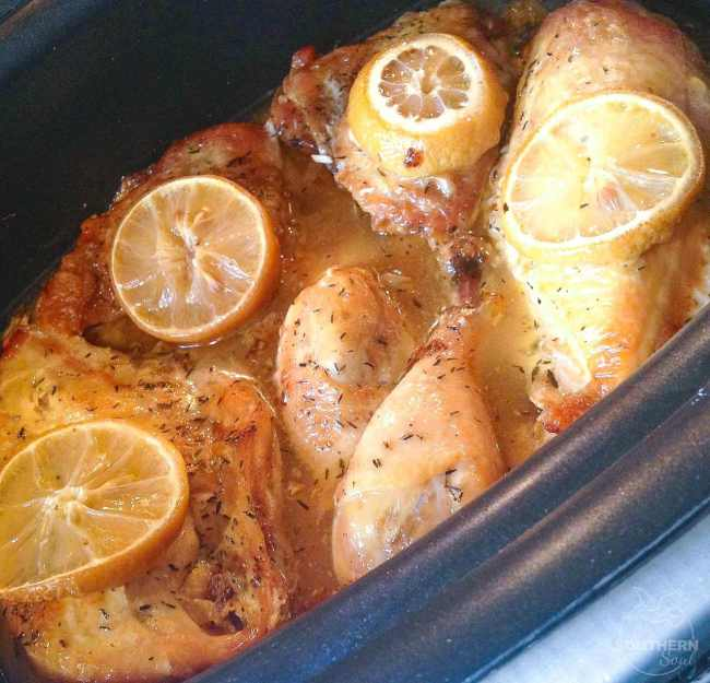 Crock Pot Lemon Chicken is an easy to make dish that's flavored with lemons, garlic and thyme. It's cooked low and slow and is fall off the bone tender.