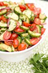 Tomato Cucumber Salad made with fresh vegetables is a simple salad with a healthy dressing of olive oil, balsamic vinegar, lemon juice and herbs.
