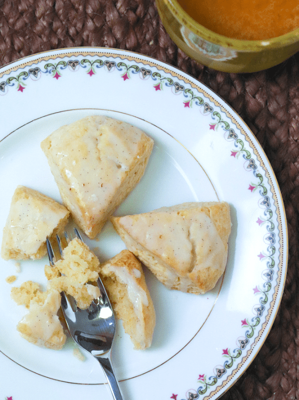 Easy to make Vanilla Scones are the perfect way to start the day! Topped with a vanilla bean glaze, these yummy treats are perfect for breakfast, brunch or as an treat with coffee or tea.