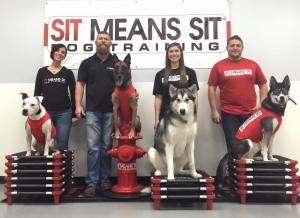 Bre and Chris on the far left with two of their dogs, Merlin and Lycan