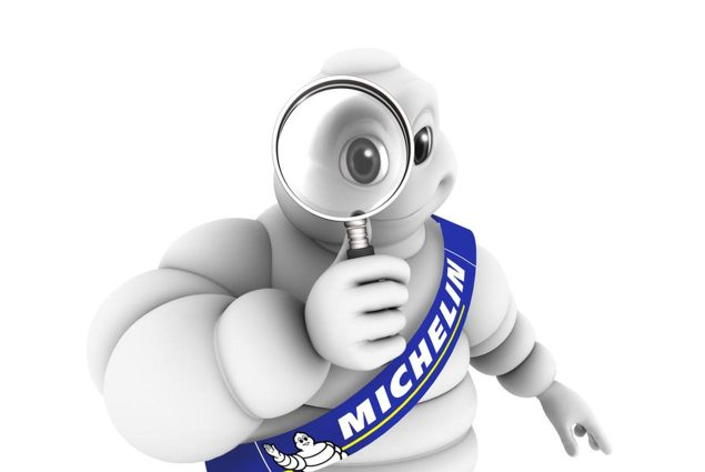 michelin-man-magnifying-glass