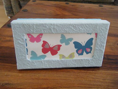 The finished DIY box with butterfly paper inserted into the lid