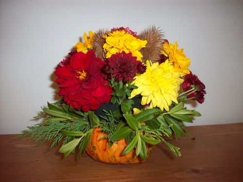 Homemade pumpkin flower arrangement for table centre piece for a budget wedding