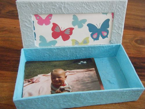 Decorated homemade box used as a memory box - blue box with photos in it and a butterfly design lid