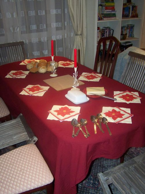 dinner table laid with a tablecloth and candles