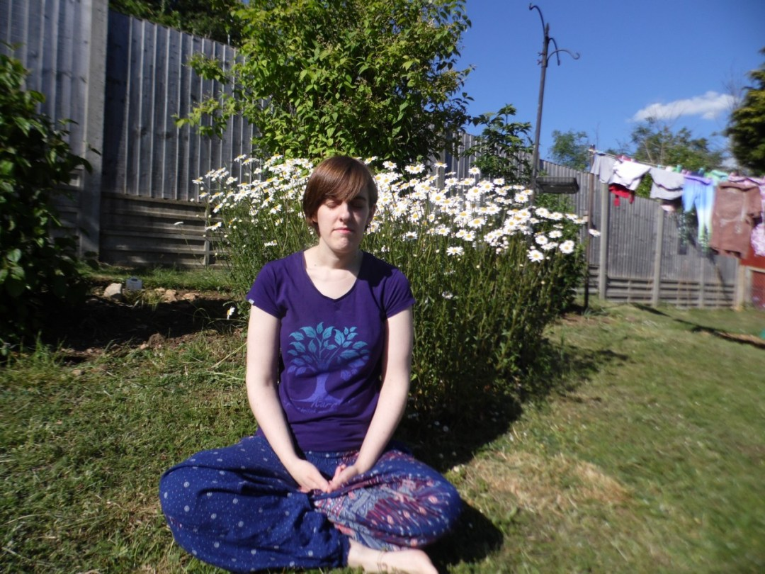 Amanda meditating in the garden
