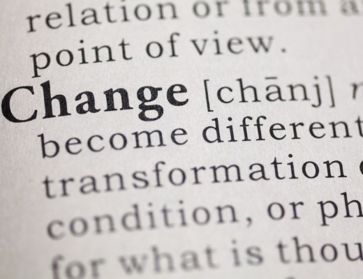 "close up image of the word ""change"" in a dictionary, with some of its description using terms such as ""transformation"" and to ""become different""."