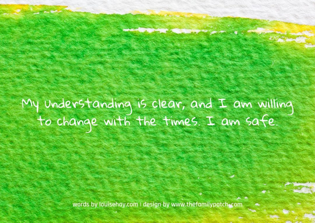 "green watercolour background with the affirmation in white text ""My understanding is clear and I am willing to change with the times. I am safe."