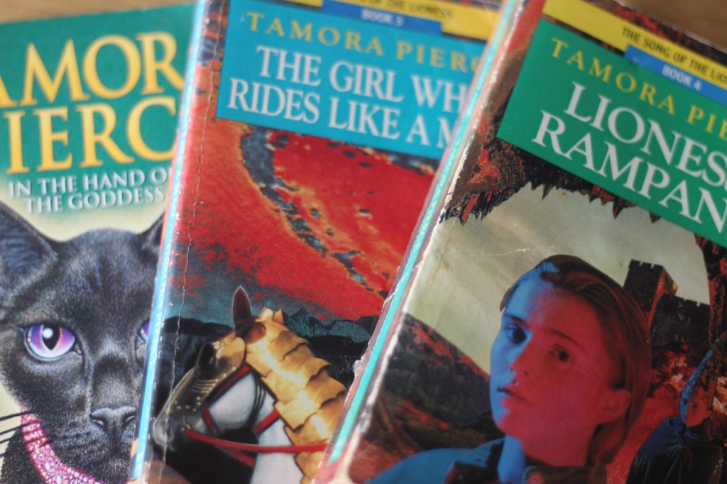 3 of Tamora Pierce's Song of the Lioness books - IN the Hand of the Goddess, The Girl who Rides like a Man, and Lioness Rampant