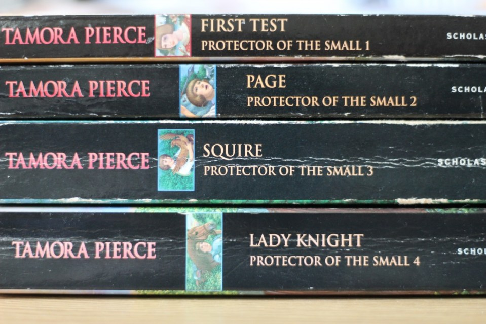 Stack of 4 books by Tamora Pierce, First Test, Page, Squire, and Lady Knight