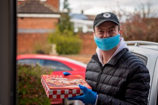 UK Pastor Delivers Pizzas and Prayers to Fund Church's Food Bank