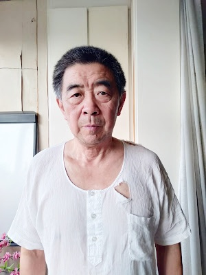 Retired Professor with Alzheimer's Arrested by Chinese Authorities After Speaking Out About Coronavirus Plague