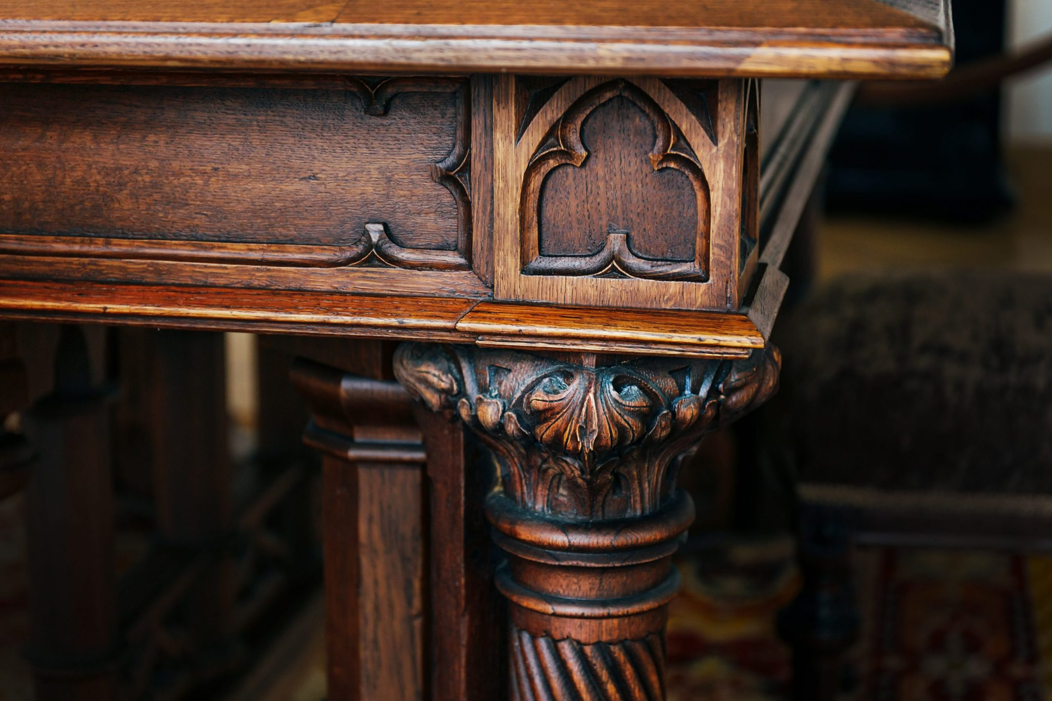 Angle and carved leg of an ancient vintage antique wooden table