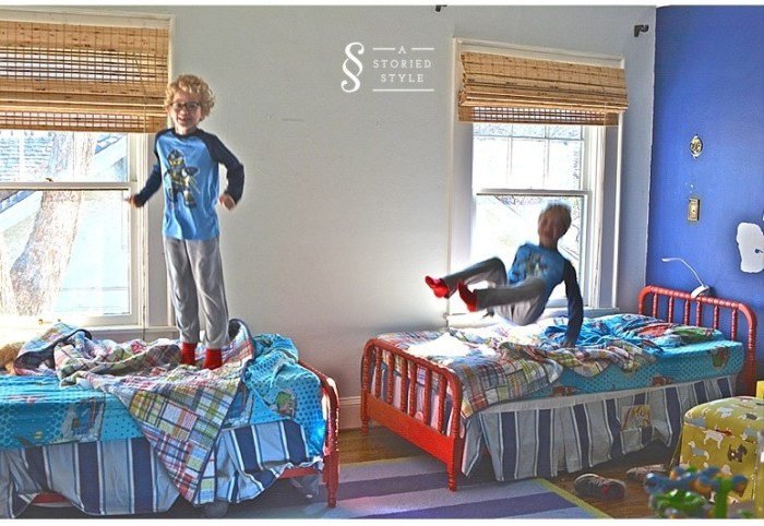 boys jumping on beds