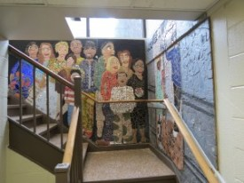 The stairway is etched with mosaic depicting former and current Astor staff and students.