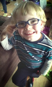 Jackson is all smiles for the camera with his first pair of glasses on!