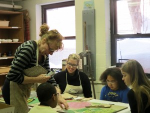 Roberta Andersen, far left, sits with Astor staff and students partaking in a weekly mosaic project.