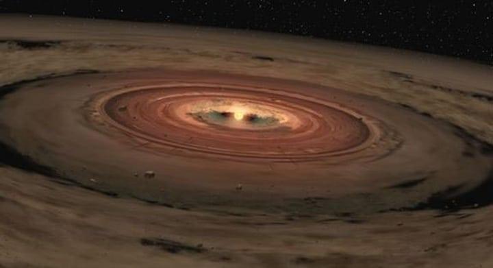Recreación artística de un disco de polvo y gas alrededor de una estrella.