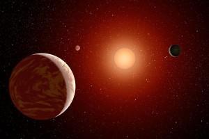Concepto artístico de una enana roja rodeada por tres planetas. Crédito: NASA/JPL-Caltech