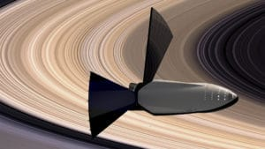 Concepto artístico del STI sobrevolando los anillos de Saturno. Crédito: Elon Musk/SpaceX