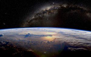 Representación artística de la Tierra y la Vía Láctea vistas desde el espacio.