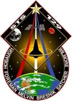Het logo van STS-129