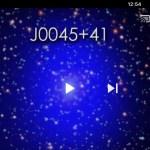 Kijk nou, twee superzware zwarte gaten 'photobomben' M31, het Andromedastelsel