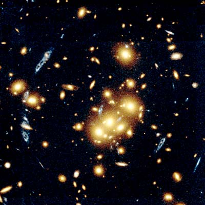 galaxy cluster warps light from distant blue spiral galaxy