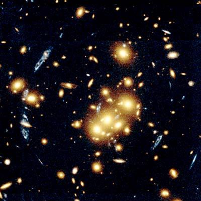 galaxy cluster warps light from distant blue spiral galaxy