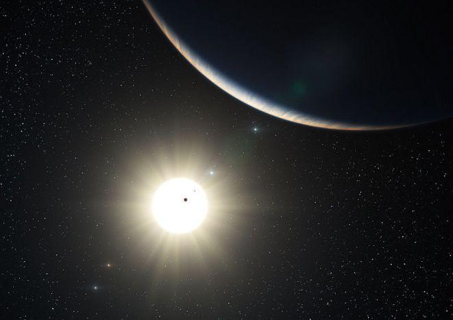 Impressão de artista do planeta HD 10180 d representando também os planetas HD 10180 b e HD 10180 c em trânsito. Crédito: ESO / L. Calçada.