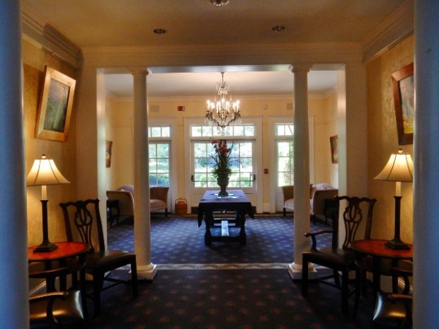 The hall entry to the breakfast room and the gardens.