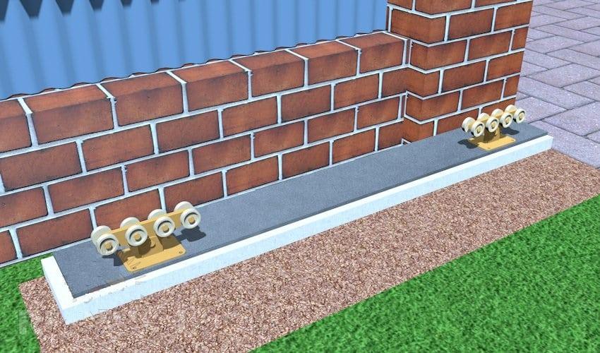 ローラーをコンクリート製の基部に固定します