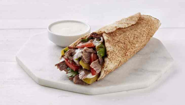 Shawarma is one of the middle eastern foods that you eat as a wrap, with tzatziki sauce on the side