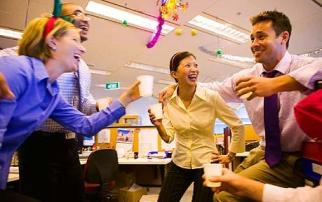Asylum Officers celebrate the positive survey results.