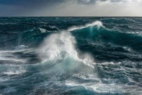 Beautiful blue open ocean waves captured during rough sea days in the Antarctic ocean