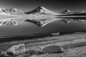 Chilean unreal volcano landscape, four volcanoes reflecting in laguna Lejia