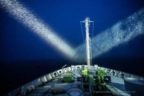 Ortelius cruise ship searchlights in Antarctica are illuminating a snow storm in Antarctica