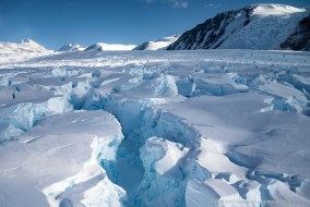 Flying low over deep glacier crevasses at Robertson Bay, Antarctica