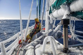 After an early Drake Passage crossing in a storm, the sailing yacht is covered in thick ice